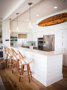 AN IDEA FOR BAR STOOLS ~~The coastal design experts at HGTV.com share 15 ways to add beachy style to any room in your home.