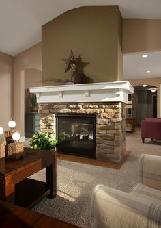 Fireplace in the sunroom, warm all year long.