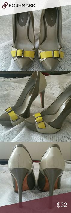"Aldo Vero Cuoio Patent Leather Heels These are an awesome pair of Aldo Patent Leather Heels  Size 37 (6.5-7) Taupe, Cream with Yellow Buckle across the Toes Very Gently Used. There is One 1/4 inch smudge on the plantar part of the left shoe. See 5th Pic Heel is 4.5"" Tall Made in Brazil Aldo Shoes Heels"