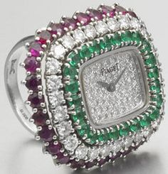LOVE this ring watch. Too bad I will never afford it...