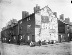 Large glass plate negative showing a view of Howell Croft North at the junction with Deansgate. Side of building is covered with posters and adverts. Taken in September Small Towns, North West, Street View, England, Places, 1920s, September, Posters, History