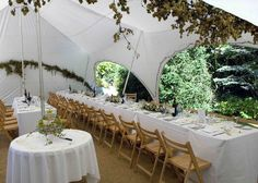 capri marquee decorated with fairy lights, hops and trestle tables