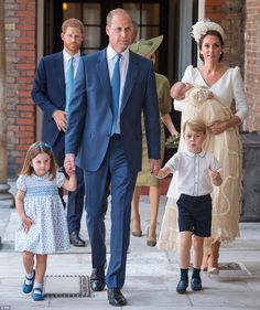 Prince William held hands with Prince George, four, and Princess Charlotte, three, while t...