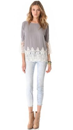 Love the concept of this top. DIY lace at bottom of normal blouse to make tunic length.