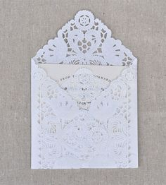 We love the mirroring of icy patterns in this lace doily envelope!