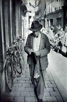 A man walking in the Getreidegasse of Salzburg, Austria, 1950s  photo by Henri Cartier-Bresson