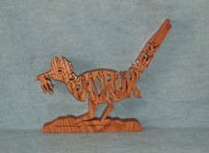 Hey, I found this really awesome Etsy listing at https://www.etsy.com/listing/81095597/roadrunner-bird-scroll-saw-wooden-puzzle