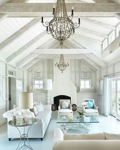Seaside Residence by Donna Elle Seaside Living. Very very pretty white living room with blue touches and wonderful architectural details.