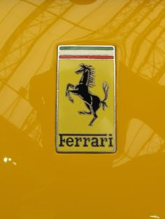 Yellow car with Ferrari logo Lolo Ferrari, Ferrari F40, Ferrari Logo, Maserati, Yellow Car, Yellow Submarine, Mellow Yellow, Car Hood Ornaments, Car Parts And Accessories