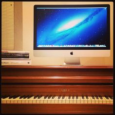 apple (mac) imac turbo hanging out on a piano.