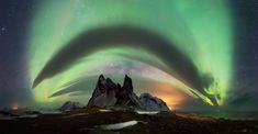 Large rollclouds were covering the sky right above the mountains and added a stormy flair to the panoramic view as the northern lights left the sky above us glowing green. Aurora Borealis, Milky Way, Natural World, Night Skies, Northern Lights, Coast, Ocean, Clouds, Sky