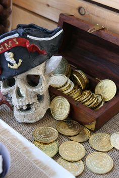 Pirate Party Ideas (For each kid, stain a small wooden box, paint their names on them, fill with chocolate coins/pennies and hide them, then give the kids a treasure map to find them. Each kid takes theirs home.)