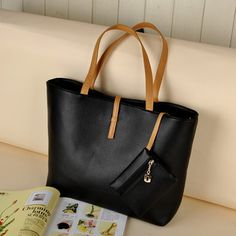 A structured tote is perfect for carrying all necessities on your commute, and stashing a clutch for after hours!