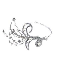 A truly stunning and very individual side head piece. This piece make a pretty alternative to a tiara.
