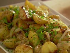 Mustard-Roasted Potatoes from FoodNetwork.com  I wish I had Doubled the recipe, it was so good! This will be one of my standby recipes! Thank you, Ina, love you!
