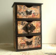 An altered dresser using mixed media techniques