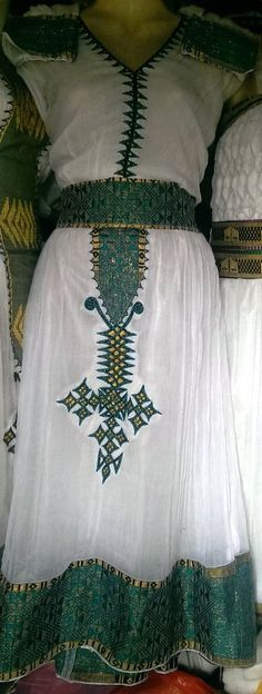 Hand Made beautiful dress straight from Ethiopia. we Ship through out the world. visit us on www.ethiotebebe.ecrater.com, ethiotebebe26 on eBay or ethiotebebe1 on Amazon.