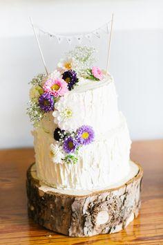 whimsical wedding cake, photo by Lea Bremicker http://ruffledblog.com/whimsical-german-wedding #weddingcake #cakes #bunting