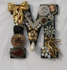 vintage jewelry monogram  This could be used as a display also.  Love the idea of making a monogram from the vintage pieces.