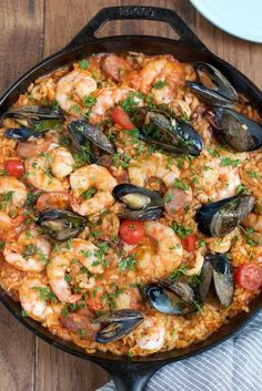 Seafood Paella - Easy delicious and flavorful Seafood Paella that you can make at home! And you dont need a paella pan!) package Shrimp from omaha Wild White Steak Saffron Recipes, Good Food, Yummy Food, Comida Latina, Seafood Dinner, Seafood Risotto, Seafood Stew, Seafood Boil, Fresh Seafood