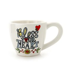 "Lorrie Veasey's Bless Your Heart Mug (as seen at Hallmarks) ""When filled with liquid you can see a heart."""
