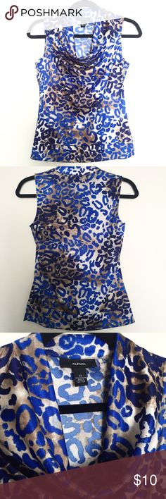 Alfani Cowl Neck Leopard Print Sleeveless Top Wear this tucked in a skirt or dress shorts! Great under a blazer or sweater. Really cute with white bottoms in the summer. Lightweight and soft with banded hip. Only  worn a few times. Excellent pre-owned condition.   Material & care: 100% polyester Machine wash cold, gentle cycle. Tumble dry low.  Cool iron when needed. Alfani Tops Blouses