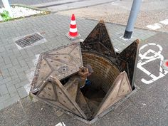 This manhole cover/entrance in Wiesbaden, Germany [x-post from /r/pics] Weisbaden Germany, Detail Architecture, Industrial Architecture, The Meta Picture, Underground Cities, Secret Rooms, Cool Photos, Interesting Photos, Concept Art