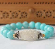 simple but beautiful... druzy! it's the tiny quartz crystals that grow in a fissure on a host stone. love this bracelet. the designer is from plano, and her store is lalijewelryshop on etsy