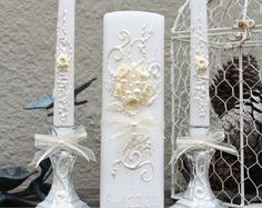 Unique and elegant Wedding Unity Candle set, hand decorated with fabric roses, bows and pearls. Colors are Mother of pearl and white. It will make a great addition to your wedding reception. Also its a PERFECT bridal shower gift! This listing is for 3 candles: 2 taper candles (12hight) and 1 pillar candle (9 x 3) Glass Candleholders are optional - 4 tall, you can order them by choosing 2 candleholders from the drop down menu under the price. Custom orders are always welcome! Candles can be…
