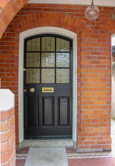 Glazed solid timber traditional front door