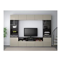 IKEA - BESTÅ, TV storage combination/glass doors, black-brown/Selsviken high gloss/beige clear glass, drawer runner, push-open, , The drawer and doors have integrated push-openers, so you don't need handles or knobs and can open them with just a light push.This TV storage combination has plenty of extra storage and makes it easy to keep your living room organized.The space-saving wall cabinets make the most of the wall area above your TV.It's easy to keep the cords from your TV and other…
