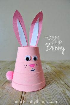 Easter activities: Bunny crafts: She taped a piece of pipe cleaner on the back of the ears so they stick into the top of the cup. I'm going to run the pipe cleaner the length of the ear to make them bendable so I can pose them. #artsandcraftsforkids,