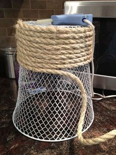 $1 waste basket wrapped with rope...this would be cute wrapped in children's jump ropes for a splash of color!