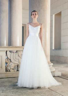Wedding dress with spaghetti straps and tulle skirt by Giuseppe Papini