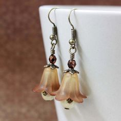 THESE are lovely!!!  Last Pair  Beige/Brown Flower Bead Earrings  by carolinascreations, $4.50