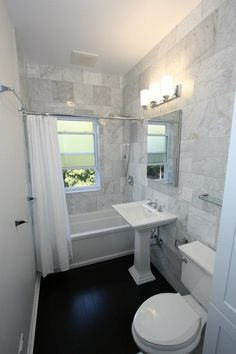 Small bathroom... Soooo pretty! I like the tile acting as an accent wall