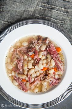 Hearty white bean and ham soup, perfect for cold winter days! White beans, ham shanks, onions, celery, carrots, garlic, Tabasco, and herbs. ~ SimplyRecipes.com