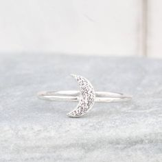 Are you interested in our Silver Crescent moon Ring ? With our Silver Moon Charm Ring you need look no further.