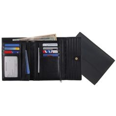 This women's Royce Leather trifold passport wallet has multiple pockets and leather construction.