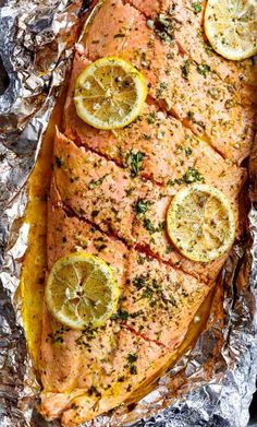 Lemon Butter Garlic Salmon with only a handful of ingredients, with maximum taste and minimal clean up! The next time I think of salmon, I'll think of this easy Lemon Butter Garlic Salmon! SALMON IN FOIL Sheet pan dinners, Salmon Dishes, Fish Dishes, Seafood Dishes, Fish And Seafood, Salmon In Foil Recipes, Fish Recipes, Seafood Recipes, Cooking Recipes, Grilled Salmon Recipes