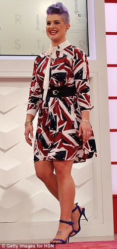 Model behaviour: Kelly modelled the clothes herself, including this Union Jack print shirt...