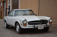 This 1971 Mercedes 280SL is an excellent original driver. Automatic with two tops. The soft top fabric will need replacing. The motor runs very strong and the original notches in the fenders are still present. White with blue interior and very solid overall. For only $39,500 #gullwingmotorcars #classiccars #buy&sellclassiccars #VintageCarBuyer #ClassicCar #antiqueCarBuyer #Mercedes-Benz #1971Mcercedes-Benz280SL