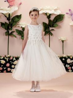 Joan Calabrese for Mon Cheri 114342 Flower Girl Dress, $297.99. Colors: Ivory, White. Fabric: Satin, Tulle And Lace. This sleeveless satin, tulle and lace tea-length A-line girl's dress has a bateau neckline, a bodice with embroidered lace flower motif with scattered sequins and three-dimensional flowers that is balanced by a thin satin set-in waistband and covered buttons down the back, and a full gathered multi-layer tulle over sequin skirt finished with wire hem.