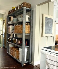 Rolling Kitchen Pantry Shelves Shortly after we moved into this house almost two years ago, we gave the kitchen a bit of a makeover. We painted the cabinets, added a breakfast bar and used our Restoration Hardware Inspired shelves as a Rolling Pantry, Rolling Shelves, Rolling Kitchen Island, Rolling Rack, Rolling Storage, Pantry Shelving, Kitchen Shelves, Kitchen Storage, Open Shelving