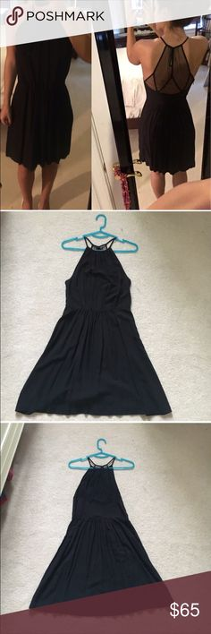 Black skater style dress Black skater style dress with see through back. Cinched/tight waist line. Excellent condition worn twice. Urban Outfitters Dresses Mini