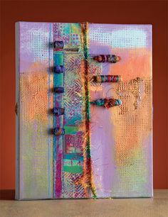 Fabric beads on canvas by Sherrill Kahn