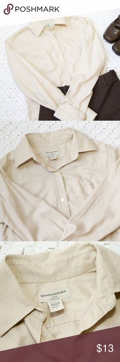 """Banana Republic Beige Long Sleeve Button Shirt Banana Republic long sleeve beige button down shirt with vertical stitching detail and button cuffs, size small. It has 1 very tiny snag 3/4 down on front (photo #5). It is barely visible. Otherwise very good condition, great for work! Smoke free home. Slacks and shoes not included. 96% cotton, 4% spandex. Approximately 17.75"""" wide under arms, 24.5"""" shoulder to hem. Banana Republic Tops Button Down Shirts"""