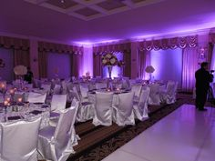 Sweetwater Country Club - Ballroom silver and purple themed wedding reception.  These special effects for room set-up can give your reception a distinctive look that truly makes your event one-of-a-kind.