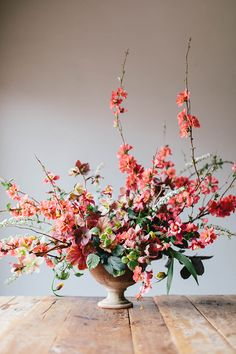 A gorgeous spring arrangement of flowering quince, hellebores, heuchera leaves, fritillaria uva vulpis, pieris, columbine, spirea, and Swedish ivy | Sarah Winward