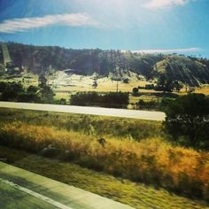 On the road #australia #countryside #hills #sun